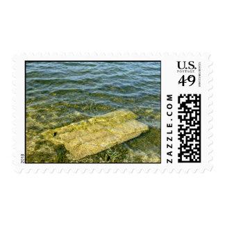 Concrete slab in pond stamp