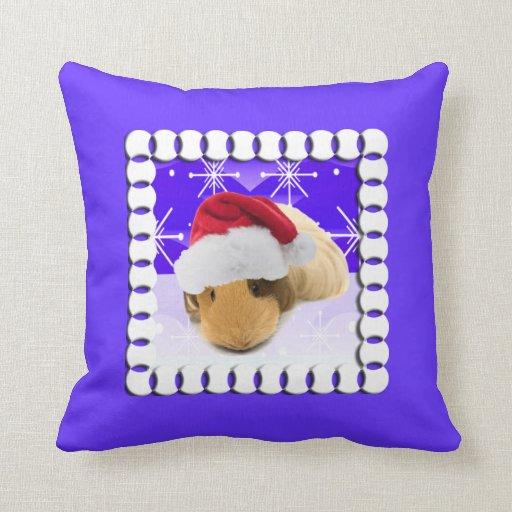 Conejillo de Indias en el gorra de Santa con los c Cojines
