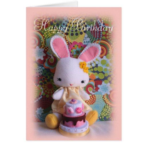 Conejito colorido del bebé con la tarjeta de cumpl