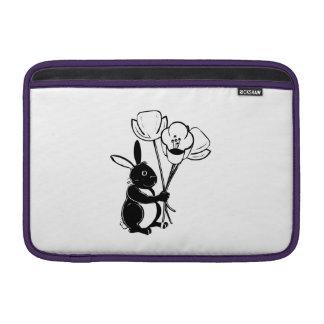 Conejito de pascua con las flores fundas MacBook