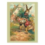 Conejito de pascua con los huevos para los niños tarjeta postal