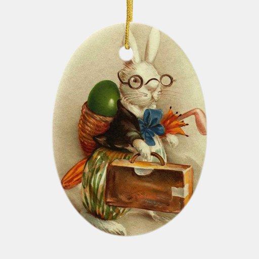 Conejito de pascua con los vidrios adorno navideño ovalado de cerámica