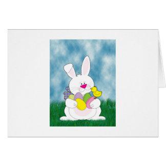 Conejito de pascua en la hierba tarjeta de felicitación