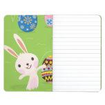 Conejito de pascua juguetón con los huevos pintado cuaderno