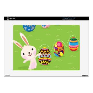 Conejito de pascua juguetón con los huevos pintado portátil 38,1cm skins