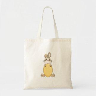 conejito de pascua lindo con el huevo amarillo bolsa tela barata