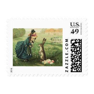 Conejito de pascua lindo de la muñeca del chica timbres postales