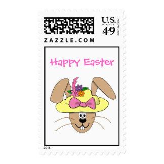 Conejito de pascua lindo del dibujo animado en un sellos