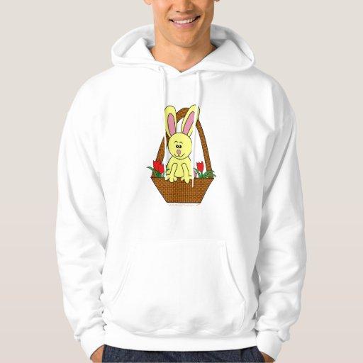 Conejito de pascua lindo del dibujo animado en una jersey con capucha
