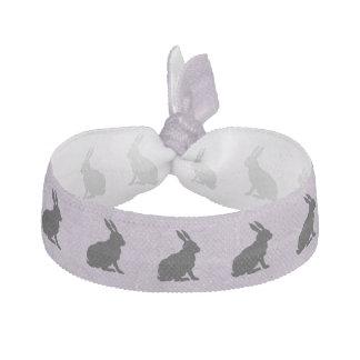 Conejito de pascua negro de la silueta del conejo goma de pelo
