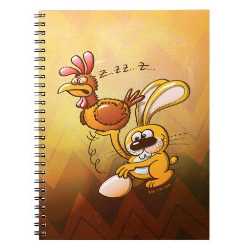 Conejito de pascua que roba un huevo de una gallin cuaderno