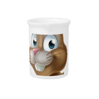 Conejito de pascua que señala de lado jarras de beber