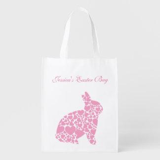 Conejito de pascua rosado de los corazones bolsas para la compra