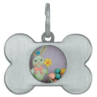 Conejito de pascua y huevos de caramelo placa de mascota