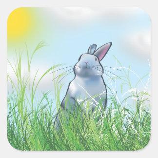 Conejito en la hierba pegatina cuadrada