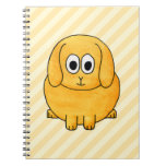 Conejito lindo del Lop, con el fondo de la raya Cuaderno