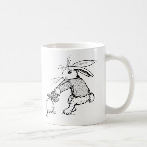 Conejito que tira en el nabo taza de café