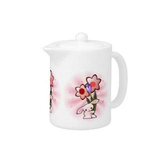 Conejito rosado lindo con las flores Pascua