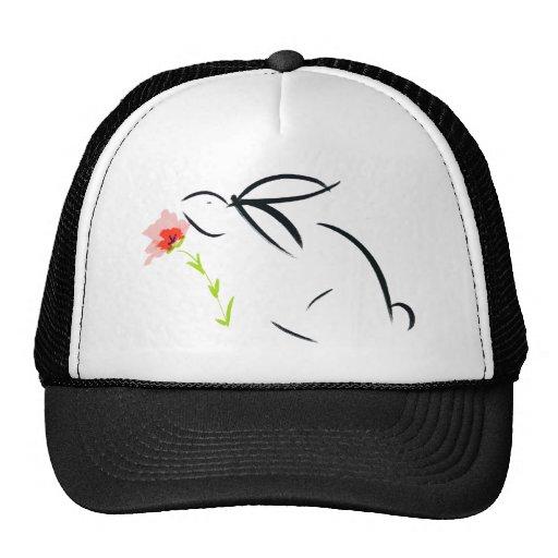 Conejito y flor gorras