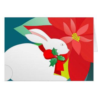 Conejito y poinsettia del navidad tarjeta de felicitación