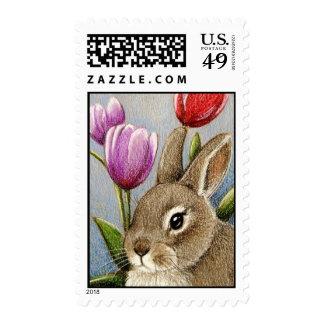 Conejito y tulipanes timbre postal