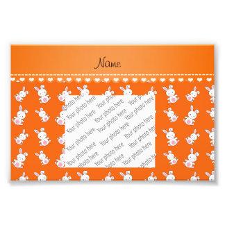 Conejitos blancos anaranjados conocidos fotografía