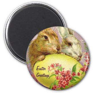 Conejitos de pascua e imán del vintage del huevo