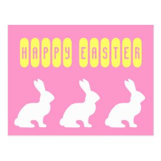 Conejitos felices del blanco de Pascua Postal
