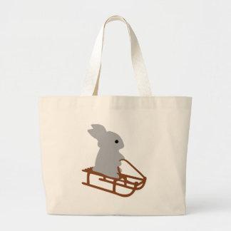 conejo agradable con el icono del trineo largo bolsa tela grande