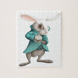 Conejo blanco con el reloj rompecabeza con fotos