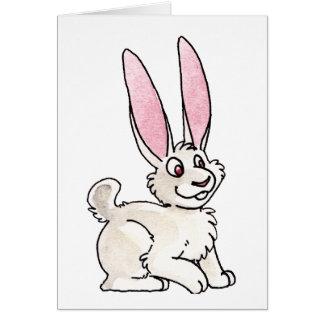 Conejo blanco que se sienta felicitacion