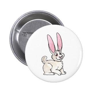 Conejo blanco que se sienta pins