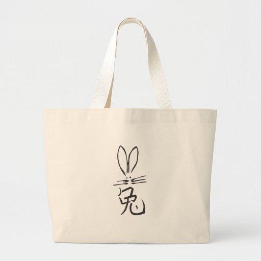 Conejo con el carácter chino bolsas