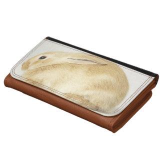 Conejo de conejito beige en el fondo blanco 4