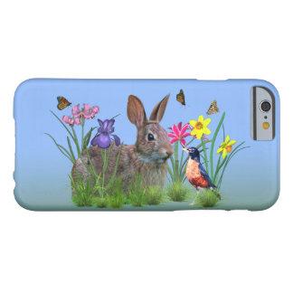 Conejo de conejito petirrojo y flores