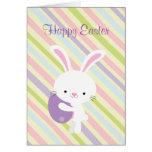 Conejo de Pascua del dibujo animado con la tarjeta