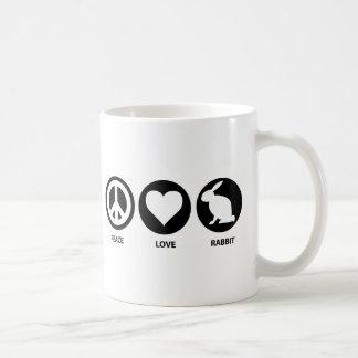 Conejo del amor de la paz tazas