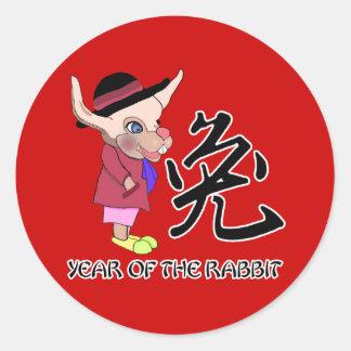 Conejo del dibujo animado con caligrafía china etiquetas redondas