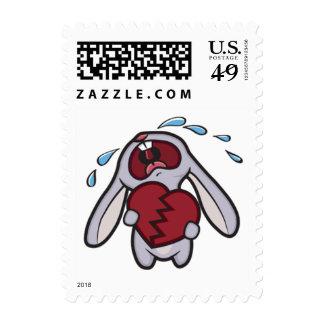Conejo gritador lindo que lleva a cabo el corazón envio