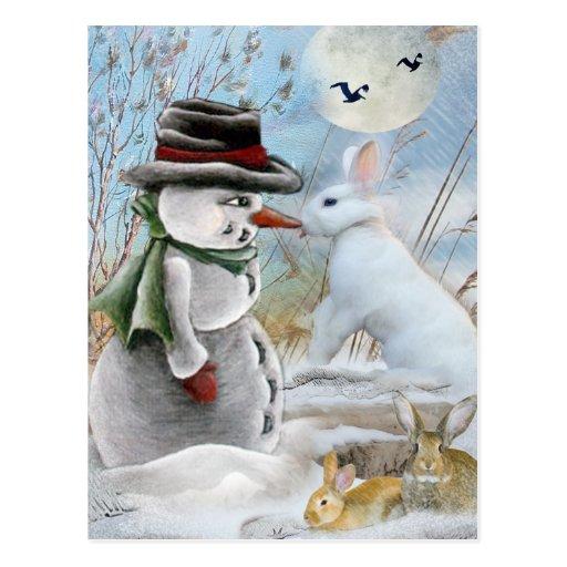 Conejo que come la nariz del muñeco de nieve tarjetas postales
