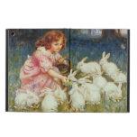 Conejos de alimentación del chica