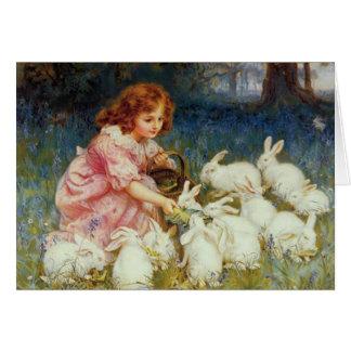 Conejos de alimentación del chica tarjeta de felicitación