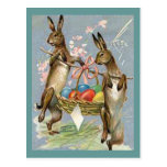Conejos de Pascua del vintage con los huevos