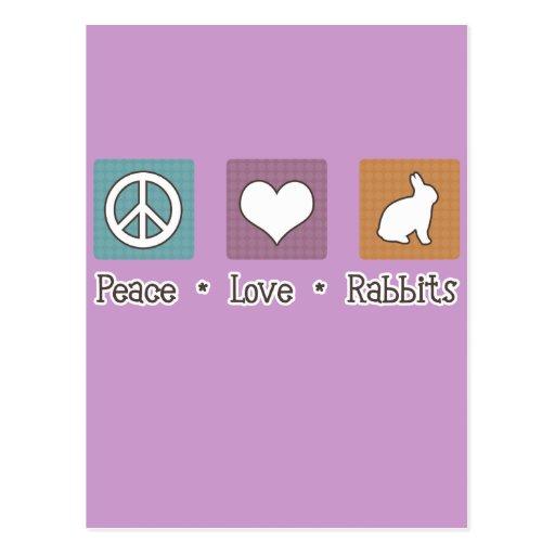 Conejos del amor de la paz postal