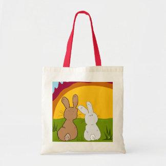 conejos en la bolsa de asas de la puesta del sol