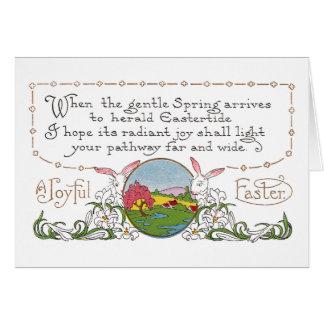 Conejos, escena colorida de la primavera y pareado tarjeta de felicitación