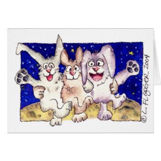 Conejos lindos del dibujo animado en la tarjeta de