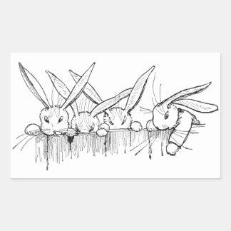Conejos que miran sobre la cerca pegatina rectangular