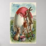 Conejos que pintan un huevo póster