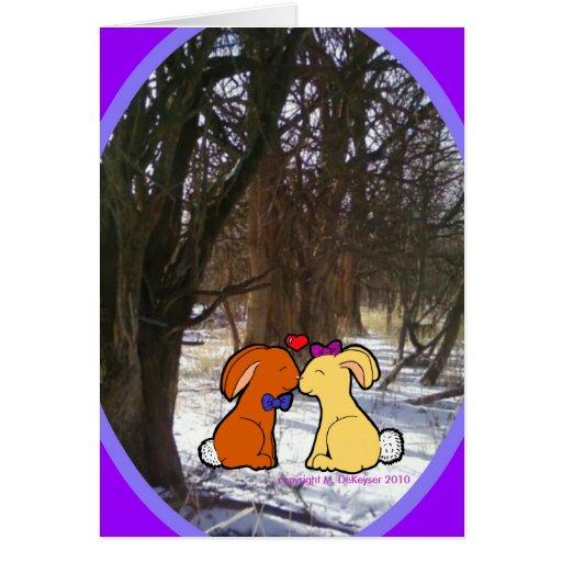 Conejos que se besan en la nieve - tarjeta del com